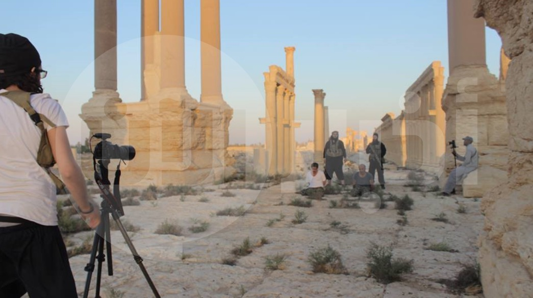A behind-the-scenes photograph supplied by Abu Ahmad showing an Islamic State execution in the city of Palmyra.