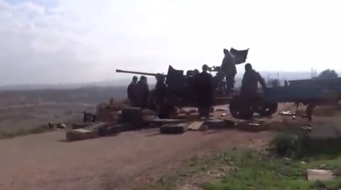 Jihadists looting the weapons stockpiles in the Syrian army base known as Regiment 111, shown here in a still shot taken from a video posted online.