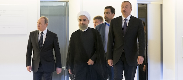 Russian President Vladimir Putin, left, Iranian President Hassan Rouhani, center, and Azerbaijan's President Ilham Aliyev, during their meeting in... </div> <a href=