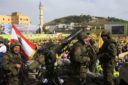 "Hezbollah fighters stand guard during a rally commemorating ""Liberation Day,"" which marks the withdrawal of the Israeli army from southern Lebanon in 2000, Nabatiyeh, Lebanon, May 24, 2015 (AP photo by Mohammed Zaatari)."