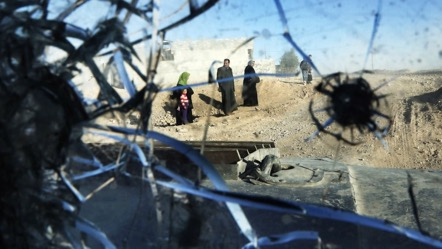 A picture taken through a vehicle's bullet-riddled windshield shows Mosul after Iraqi troops retook most of the city from the Islamic State. The group's so-called caliphate looks nothing like the caliphates of old, which thrived on diversity. (Thomas Coex/AFP/Getty Images)