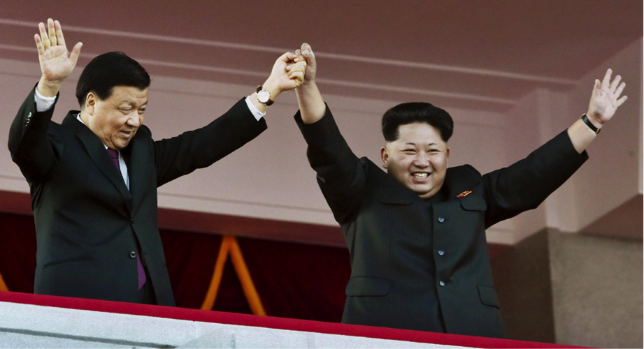 Chinese Communist Party official Liu Yunshan with North Korean leader Kim Jong-un in Pyongyang. Photo: Kyodo/Reuters