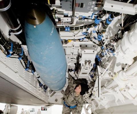 An airman inspects a JDAM being loaded onto an F-22 Raptor. (SENIOR AIRMAN J. STEFFEN/U.S. Air Force)