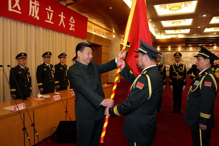 Chinese President Xi Jinping presents a military flag to Commander Song Puxuan and Political Commissar Chu Yimin of the Northern Theater Command in Beijing on Feb. 1. PHOTO: ASSOCIATED PRESS